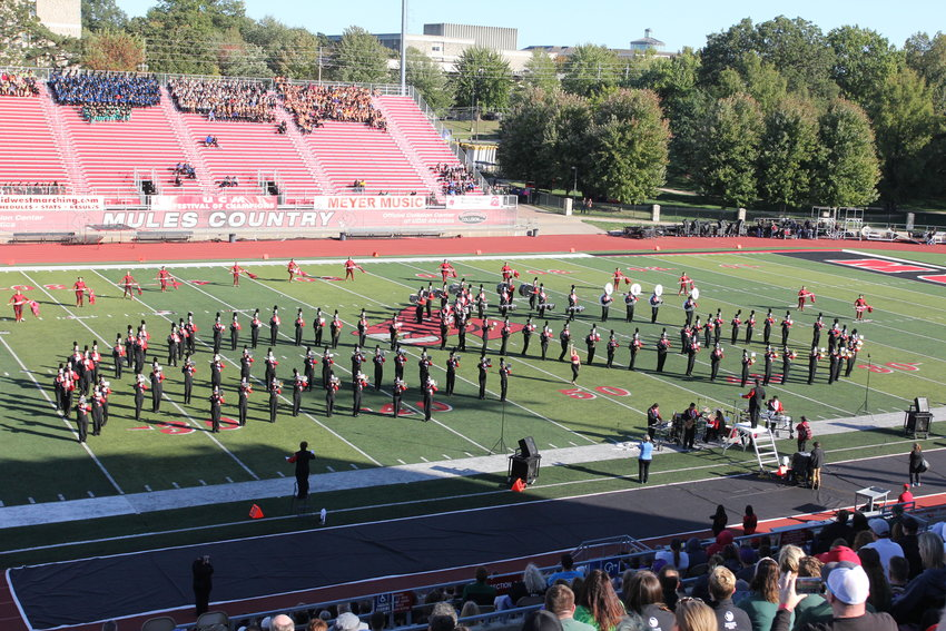 The University of Central Missouri Marching Mules perform between the preliminary and finals at the 41st annual Festival of Champions on Saturday, Oct. 16, at Walton Stadium.
