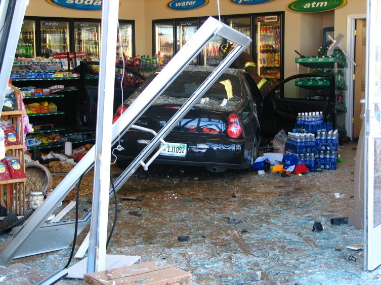 After going off US-23, this car narrowly avoided colliding with several cars in the BP Gas Station Parking lot and slammed into the party store.