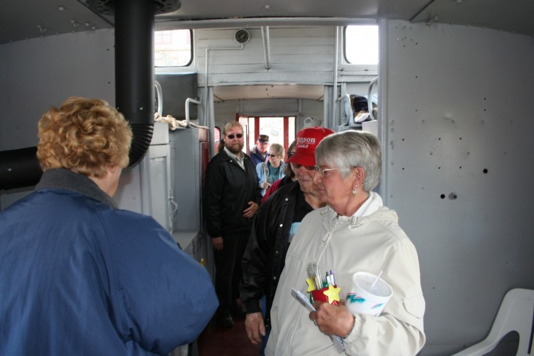 People check out the inside of the renovated caboose.