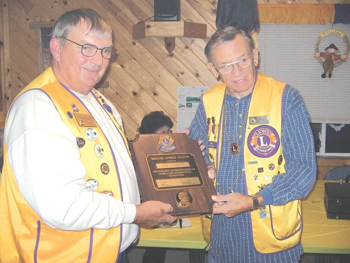 The Fairview/Comins Lions Club recently awarded Lion Bud Vincenti a Melvin Jones Award. Lion Mike Riskovitch (left) from the Rose City Lions presented the award to Vincenti.
