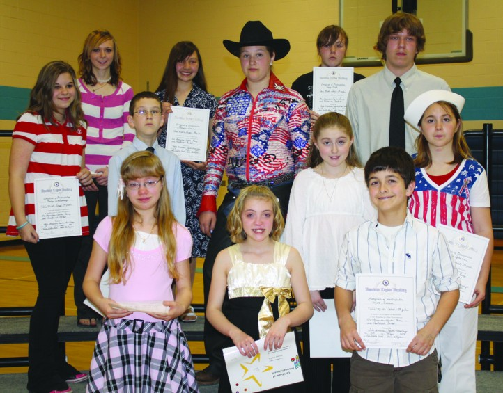 All the oratorical contestants are: (l-r) (back) eighth-grader Jessica LaBranche; Lauren Brown, first place oratorical, second place written (eighth grade); Darby Barnes, second place written (seventh grade); Kasey Mick, first place written (eighth grade); seventh-grader Josh Smith; (middle) Emily Montgomery, second place oratorical, first place written (seventh grade); sixth-grader Dylan Augustyniak; Jadie Hutchings, second place written (sixth grade); Brooke Johnson, first place written (sixth grade); (front) Ariel Everitt, second place written (fifth grade); fifth-grader Haliee Haskin; and Matt Anderson, third place oratorical, first place written (fifth grade).
