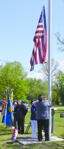 American Legion Post 370, Skidway Lake, Commander Larry Boyce, and Auxiliary President Dee Joseph raised the flag during the Memorial Day service.