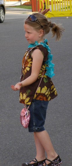 Five-year-old Zoey Brown of West Branch copies the belly dance moves that were demonstrated Friday evening.