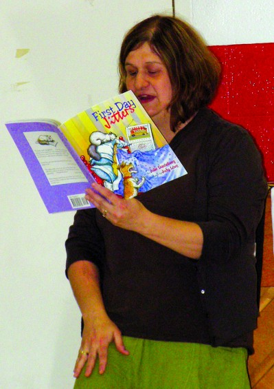 "New Rose City schools Principal Jill Retherford reads ""First day jitters"" to the elementary students."