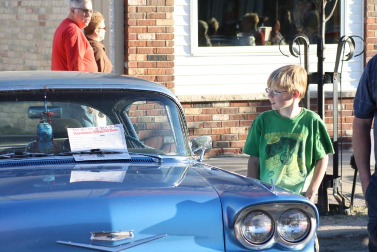 Emerson Kloostra, 9, dreams of taking a spin in one of the classic cars on display at the Classy Chassis event.