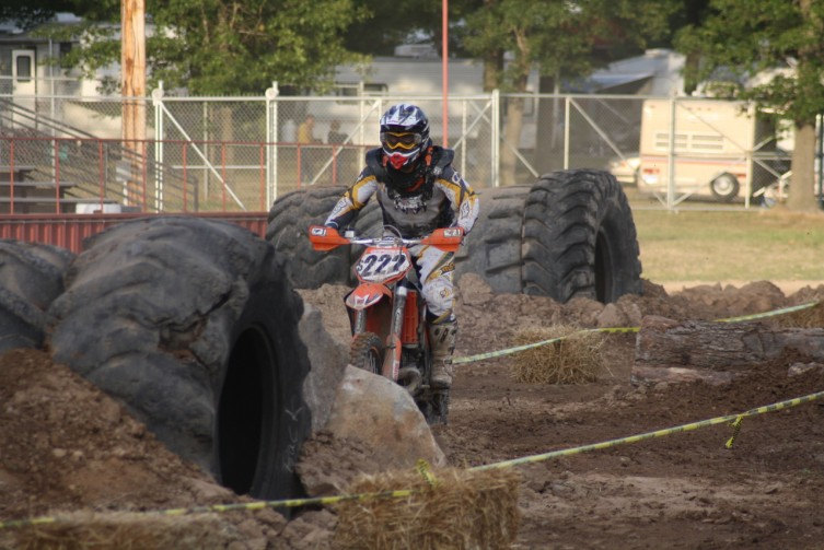 Joe Mapes sizes up one of the many obstacles on the course, this one consisting of a set of huge tires.