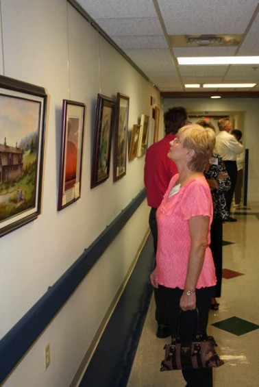 Judy Kohlschmidt of Gladwin takes a look at some of the other artwork that was submitted for the show. Kohlschmidt had some of her work on display.