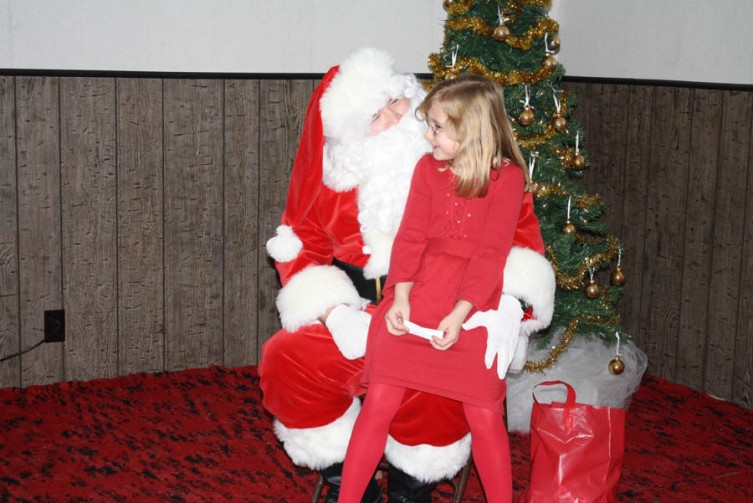 Sally Pudvan, 7, of Hardwood Lake tells Santa what she wants for Christmas this year.