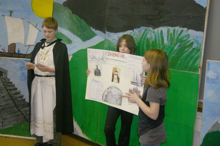 """From left, Surline Middle School fifth grade students Joshua Hughey, Makenzie Tuchel, and Emmy Reeves talk about the adventures of Zheng He (1405-1433), a Chinese explorer who traveled to many lands in SE Asia. Students in Mr. Aksamitowski's and Mr. Carroll's fifth grade class gave presentations on several different explorers as part of """"Explorer Interviews"""" at the middle school Friday, Dec. 18."""