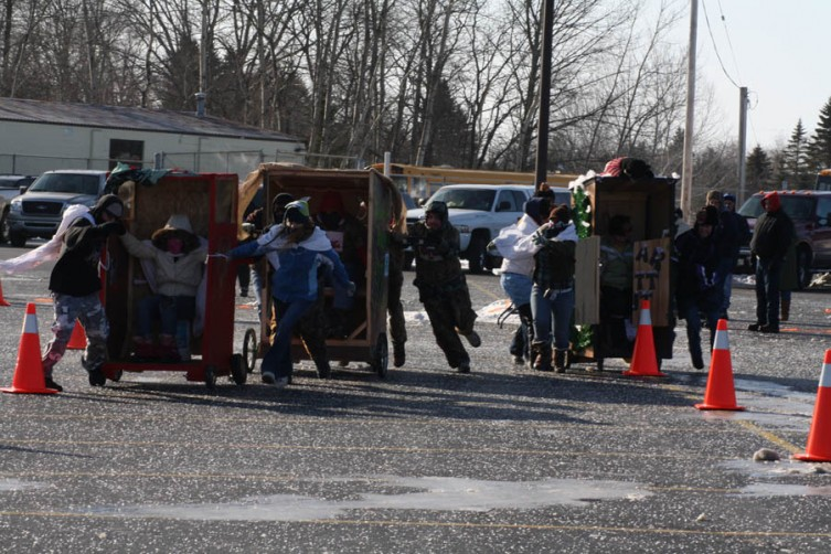 One of the big hits of the day was the outhouse race, held at Hale Elementary School. Here, three teams battle off the start.