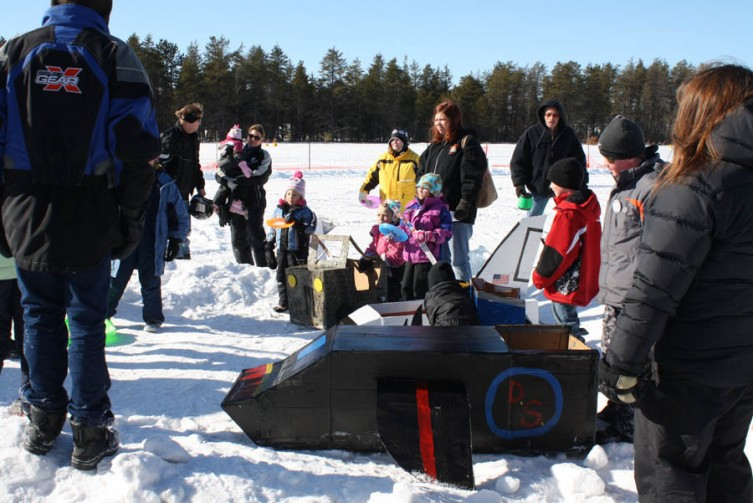 The kids are awarded prizes following the cardboard box sled race.