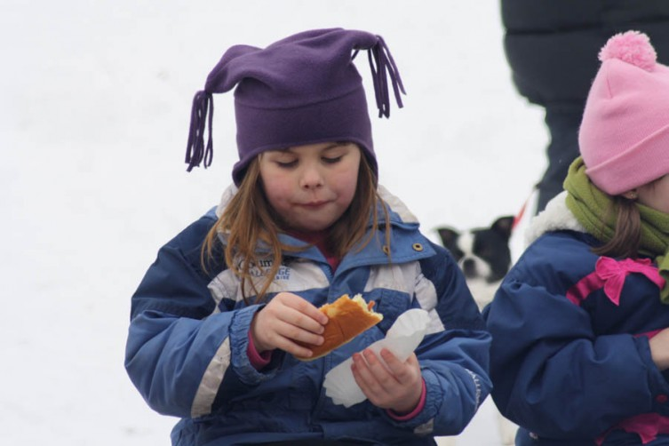 Makenzie Colby, 5, of Rose City samples one of the hot dogs.