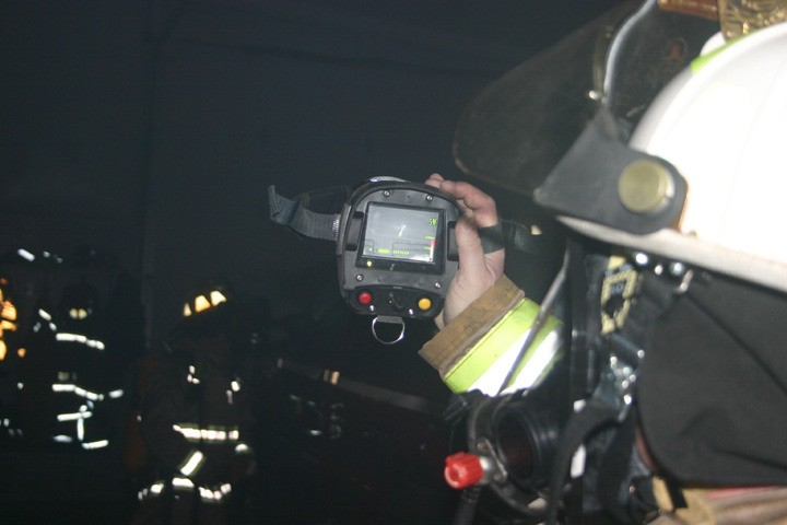 Lupton Fire Chief Wally Scott demonstrates the thermal imaging camera.
