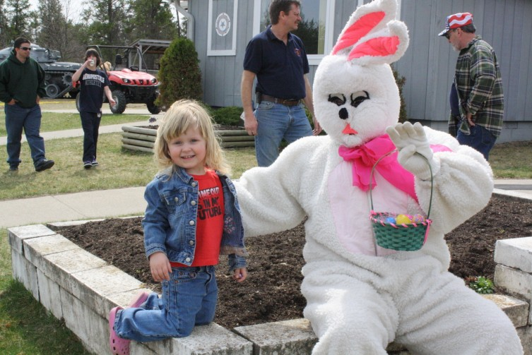 Megan Bouplon and the Easter Bunny share some candy at the Amercian Legion in Luzerne