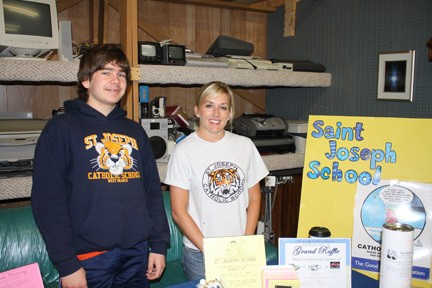 Nathan Ward, 13, left of West Branch stands with Monica Green at the Saint Joseph School booth at the A day for Charity fundraising event.