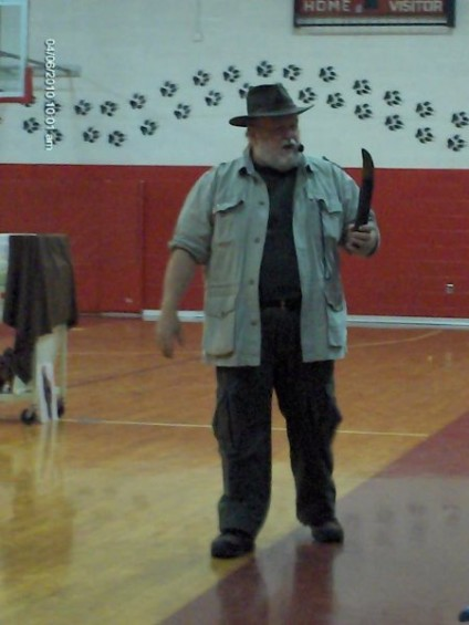 PaleoJoe and a dinosaur bone at the Rose City Middle School Gym