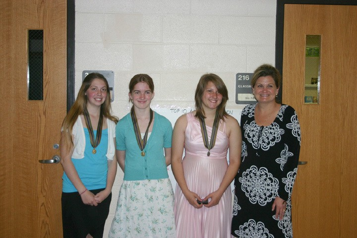 The following Hale Middle School students earned awards during the oratorical portion of the American Legion Essay & Oratorical Contest May 13: (from left) Alisa Kelso, eighth grade, third place; Kaylee Bernard, seventh grade, first place; and Melissa Solgot, eighth grade, second place. Joining the students is teacher Kelly Frank.