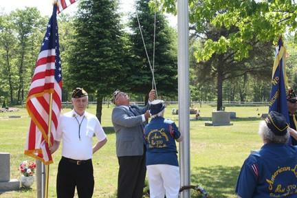 Commander Larry Boyce and Unit President Denelda Joseph raise the American flag concluding the ceremony.