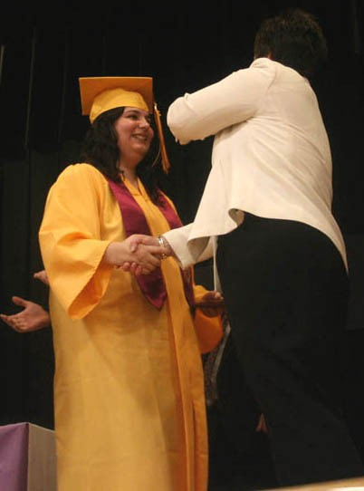 AGS class of 2010 grad Madison Hooey, gets her tassel switched to the other side by school superintendent Anne Doriean during the schools commencement ceremony Friday night .