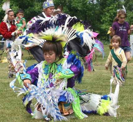 A dancer take part in the 2010 Honoring Saganing Powwow, inside of the powwow arena behind the Saganing Tribal Center on Saturday, in Standish. Both young and old, and people of native or non-native descent got to take part in the spiritual ritual.