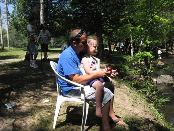 Grace, 4, and Nick Deshone of Freeland fish together on the banks of Houghton Creek.
