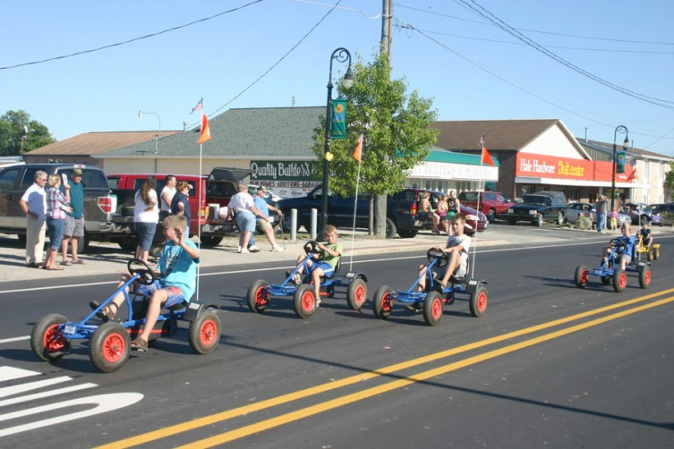 A group of children take a ride through the Hale parade.