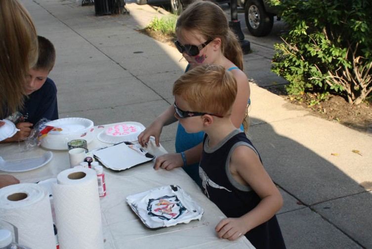Joshua Tolfree, 5, and his sister Courtney, 7, of West Branch try their hands at shaving cream painting.