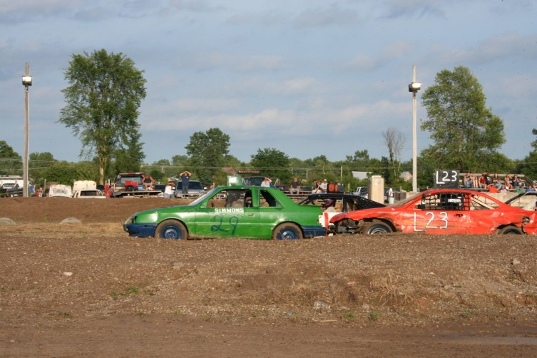 Drivers go bumper-to-bumper down the straightaway at the Bump N Grind, which was held at the Arenac County Fair in Standish on Thursday, July 23.