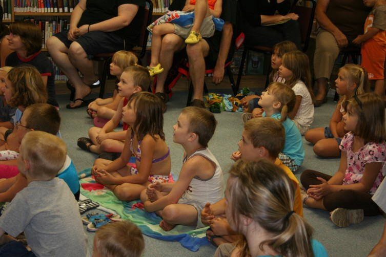 Children watch as Dufford sings rock and roll songs.