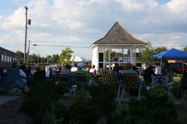 People come out to enjoy the music of Lenny Hicks and great weather in Standish.