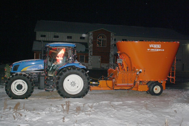 This farm vehicle on M-55 in West Branch is decorated with a lit Santa Claus and some Christmas lights.