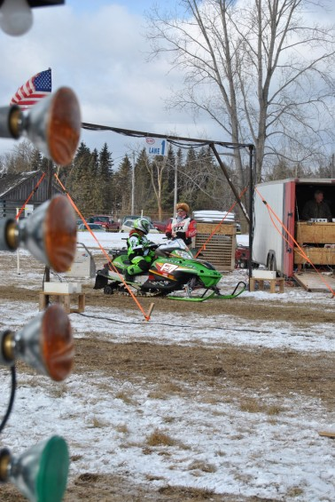 Mikayla McCane waits at the starting line for some new competitors to line up. An experienced rider, this 15 year old from Twining owns eight Arctic Cat snowmobiles.