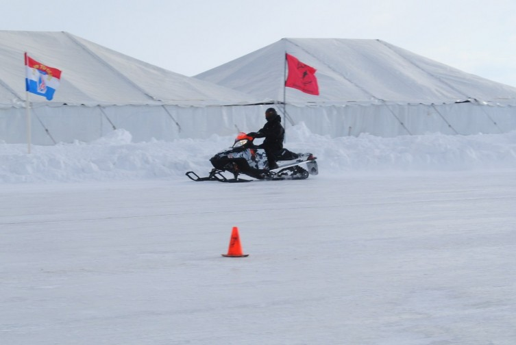 It's a tough job, but somebody's got to do it! Volunteers were spotted testing out the race track.