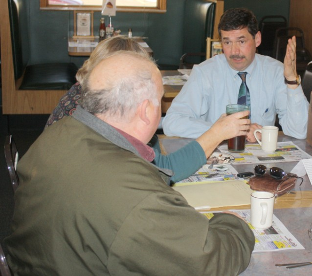 State Rep. Peter Petallia, R-Presque Isle, talks to Bill and Judy Stillion of Alpena during a March 7 visit to the AuSable River Restaurant in Mio.