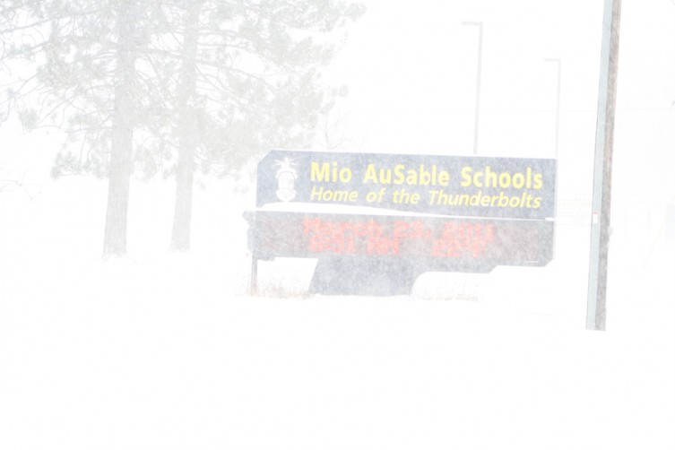 The winter storm obstructs the view of the electronic sign in from of the Mio AuSable school building.
