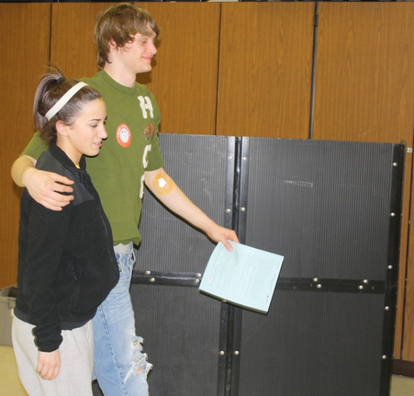 Mio AuSable sophomore Cheyanne Powell assists senior Dylan Curtis to the canteen after Curtis is finished donating blood.