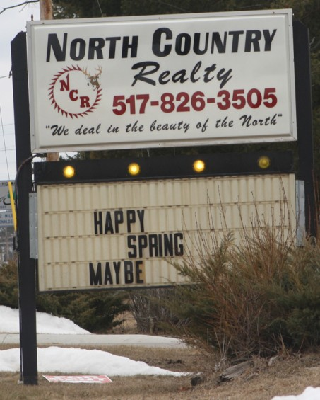 This sign outside of North Country Realty in Mio indicates that the realtors are not sure spring has truly arrived.