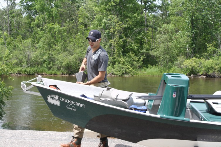 Tom Christy of Royal Oak readies his boat at the AuSable River public access site in Mio, as he prepares to go fishing on the river.