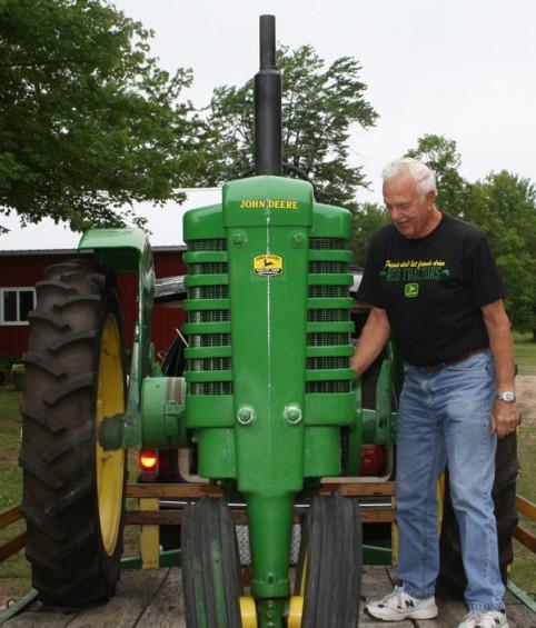 Larry Turner of Lapeer tries to start a 1942 John Deere tractor.