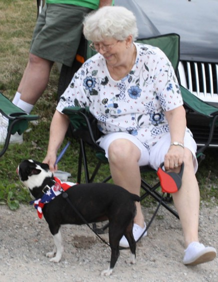 Jean O'Leary, of Westland, along with her dog Samantha, waits for the parade to start.