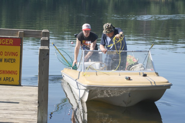 Tim Maynard, at left, of Harrison Township, and Jonathan Maynard, of Prescott, depart the public access site in hopes of catching some fish.