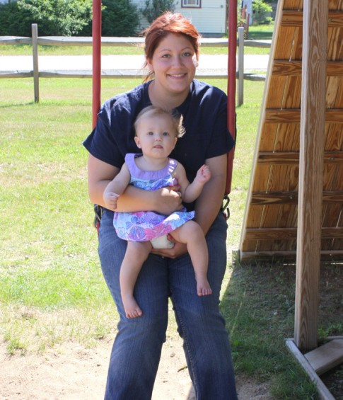 Nicole Yoder of Comins takes a ride on the swing with daughter Brooklyn, 7 months, at the Oscoda County Community Park in Mio on Friday, July 29.