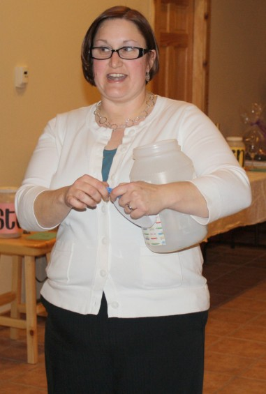 Mio Postmaster Annie Miteen announces the winning number for one of the auction baskets.