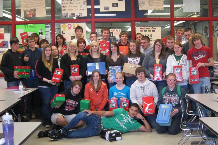 Members of Whittemore Prescott High School's Jeff Erickson's Criminal Justice class pose with the shoe boxes they put together for their community project Operation Christmas Child.