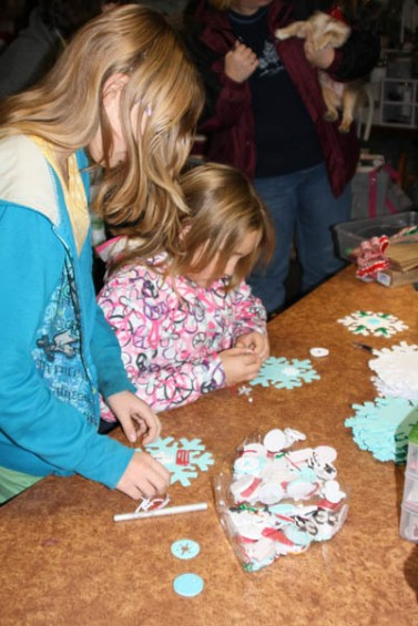 At Pleasantries, kids like Cassidy, left, and Morgan Berry made ornamental snowflakes custom decorated however they saw fit.