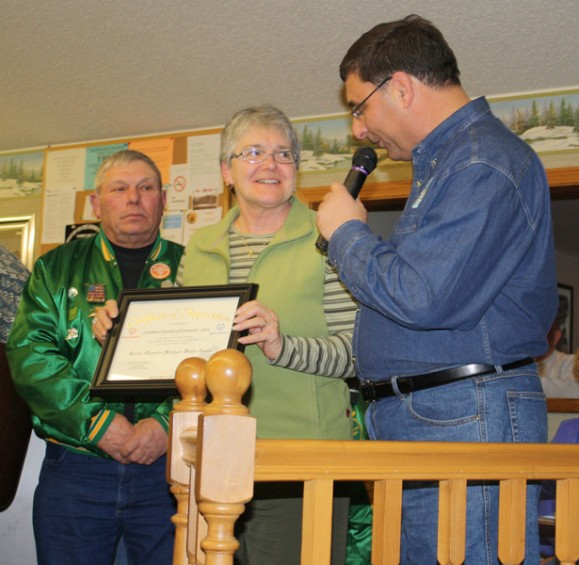 Ken Mattei, at right, of the Wertz Warriors presents a certificate of appreciation to Elaine Dixon, chairman of the Lewiston Area Chamber of Commerce Board of Directors, as Wertz Warrior Tom May, at left, looks on.