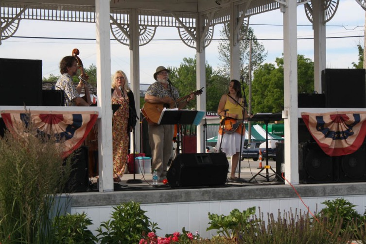 Johnny Hunt, center-right, leads the band in a song about partying as a member of the AARP.