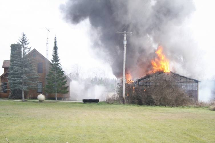 Firefighters arrived at 269 Zimowske Rd. to find this barn fully engulfed, threatening the house.