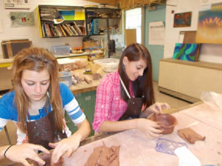 Art 1 students, Whitney Kann and Taylor Winchell working with clay making bowls for the residents at the AuSable Valley Nursing Home.