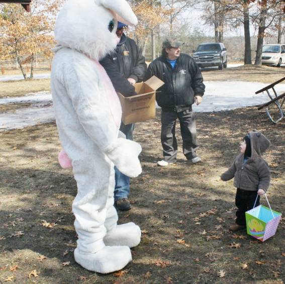 Ryker Harris, 16 months, of Mio is hesitant to get a hug from the Easter Bunny.